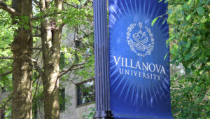 A bannar for Villanova University hangs on its campus.