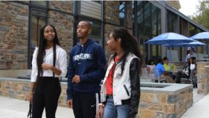 Three students at Cheyney University talk on campus.
