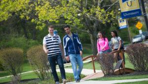Students on the Neumann University campus.