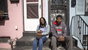 Adrienne Gilbert and Harry Lewis outside Gilbert's home.