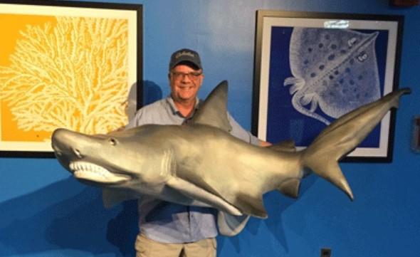 Norwood Artist Carves Eight-Foot Shark for Adventure Aquarium in Camden