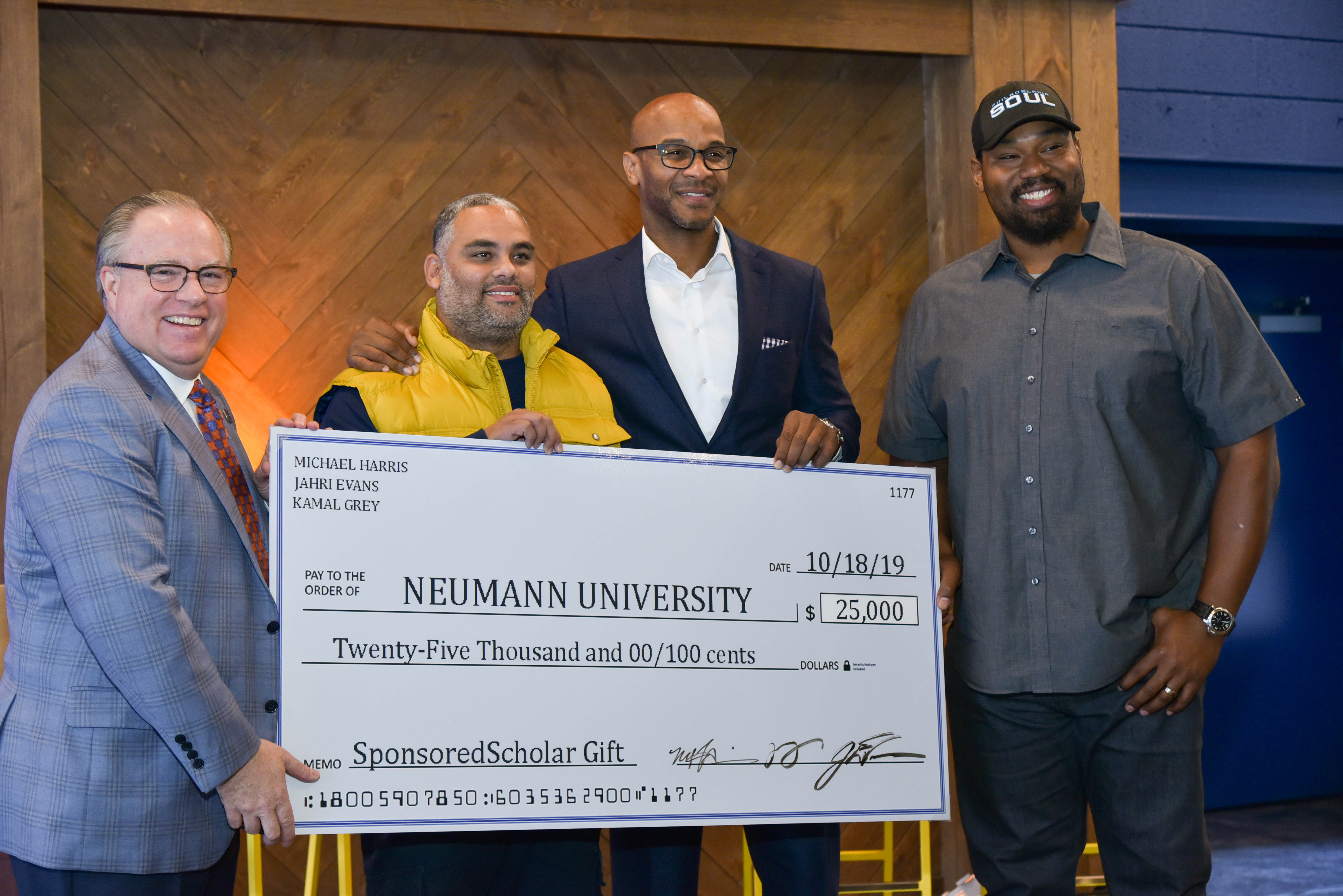Kamal Gray of The Roots Gives to Neumann Scholarships