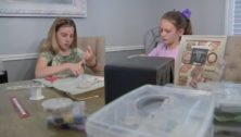 Ava DeGuio (left) and Sophia De Guio in Dreel Hill assemble a Delco Beads bracelet.