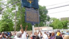 A crowd celebrates installation of a historical marker for the Nile Swim Club in Yeadon.