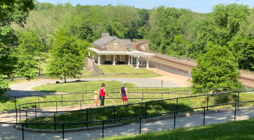 A family walks toward Valley Forge Train Station in Valley Forge park