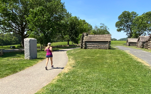 A runner jogging the trail in Valley Forge National Park