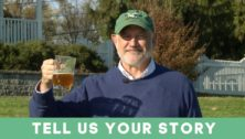 """Glen Macnow holding a beer, promoting the WIP radio segment 'Tell Us Your Story."""""""