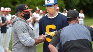 Marple Newtown and Strath Haven head coaches Rick Zimmerman, left, and Brian Fili greet Springfield's A.J. Grande.