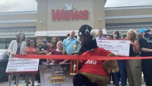 """The ribbon cutting for the new Upper Darby Wawa featuring """"Mare"""" actress Kassie Mundhenk and show technical advisor Detective Christine Bleiler."""