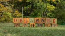 Delaware County spelled out in blocks on a lawn.