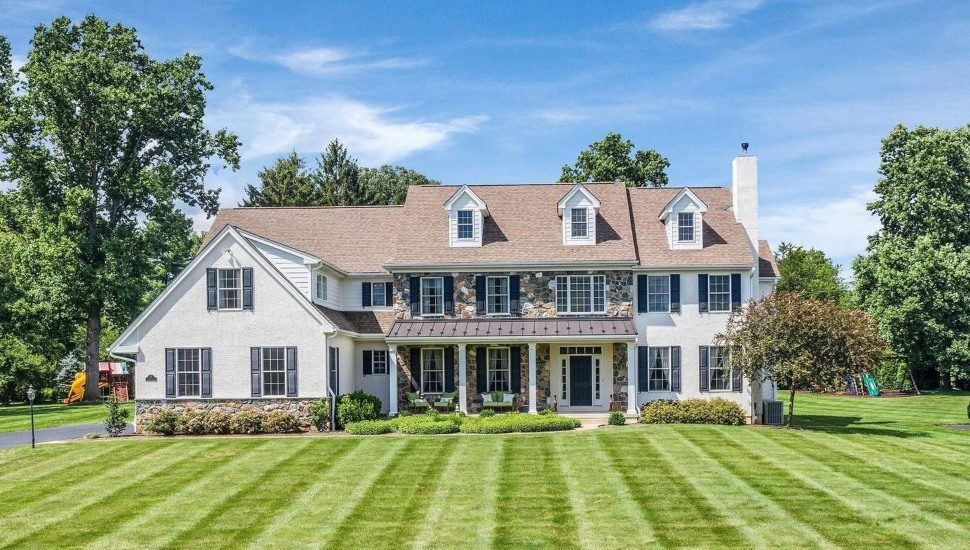 A farmhouse-style home for sale at 9 Blantyre Circle in Thornton.