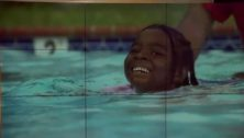 Little girl swimming in a pool.