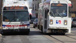 A SEPTA bus and trolley side by side.