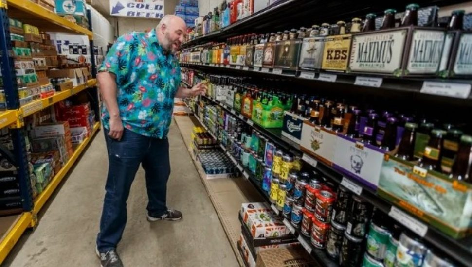 A man buying liquor at a bottle shop in East Falls.