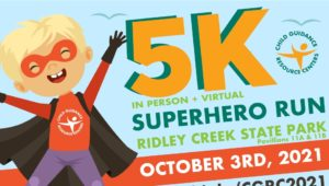 A sign promoting Child Guidance Resource Centers Superhero 5K.