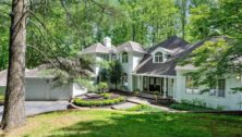 A traditional home surrounded by a wooded area at 26 Clayburgh Road in Thornton.