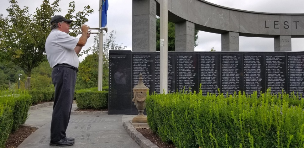 Martin Holahan playing Taps at the Delaware County Veterans Memorial in Newtown Square.