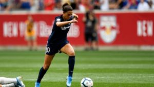 Carli Lloyd runs with the ball at a 2019 soccer game in Harrison.