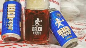Two cans and a beer stein of DelcoFest beer from 2SP.