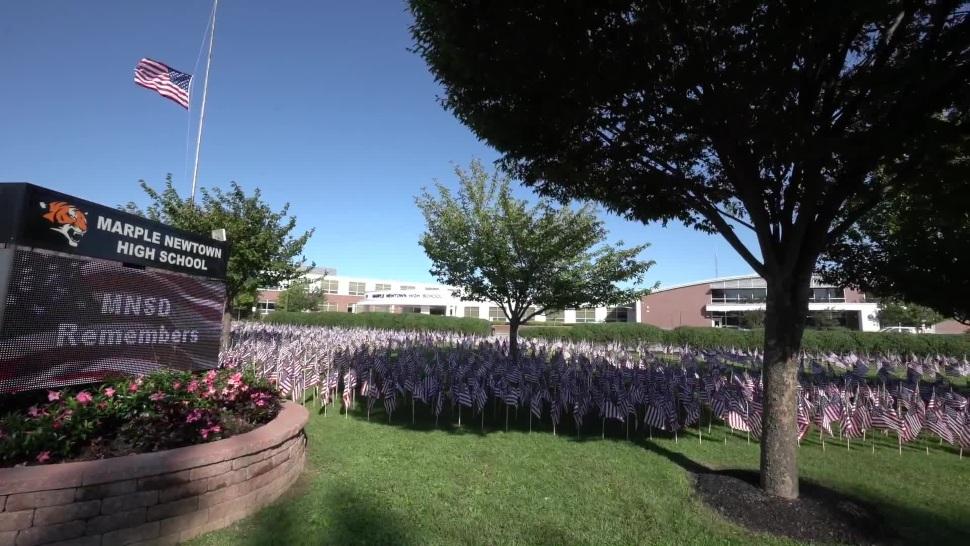 A field of American flags outside Marple High School