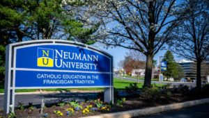 The entrance sign at Neumann University in Aston