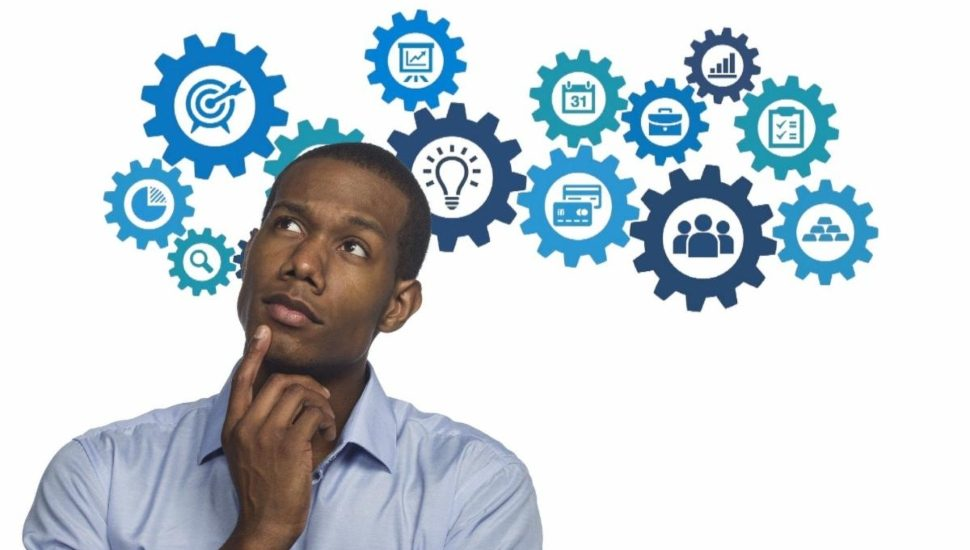 A Black man thinking about the many different ideas for running a small business.