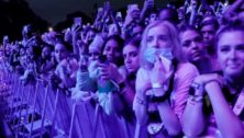 A crowd attends a Made in America concert, mostly without masks.