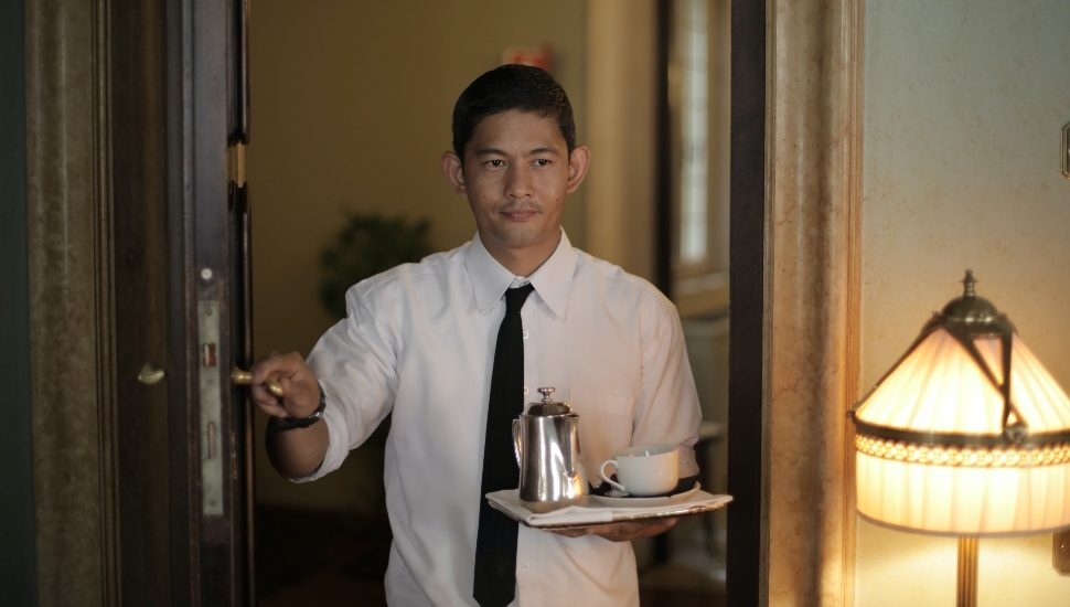 room service employee with coffee