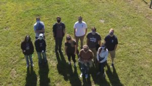 Aerial shot of GEV students with a drone at Willow Creek Farm Preserve.