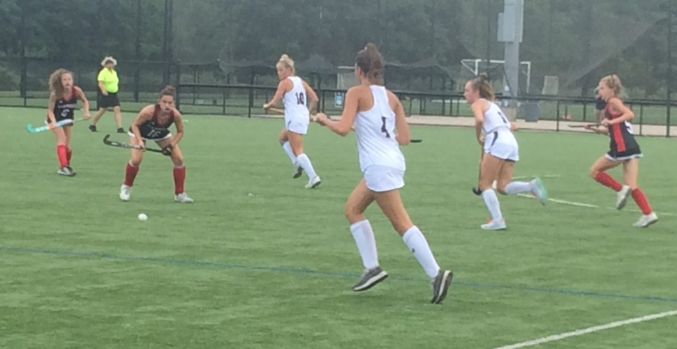 The field hockey squads of Archbishop Carroll and Cardinal O'Hara on the field at a game.
