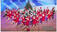 The Upper Darby Shooting Stars perform holiday songs on stage.